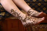 Henna tattoos on foot for girl, women