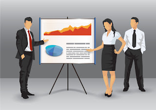 3 Salespeople standing next to a flip chart to explain a key concept from their presentation