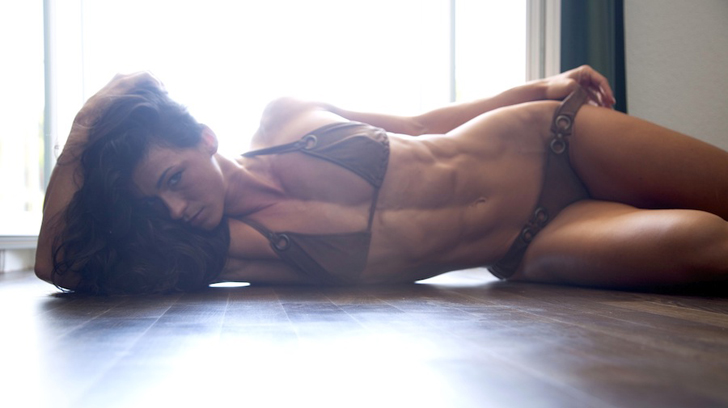 Cindy Landolt Flexes Her Washboard Abs In A Brown Bikini