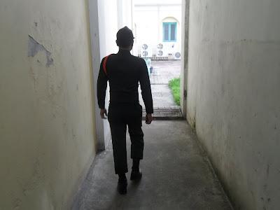 guard-leading-me-corrections-museum-bangkok-thailand.JPG