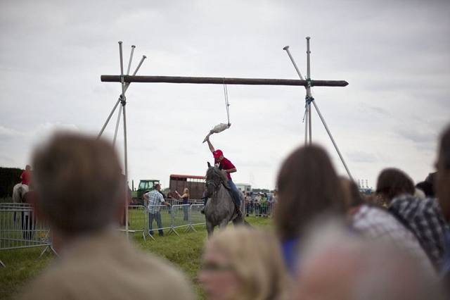 Goose pulling is an old sport originally played in parts of the Netherlands, Belgium, England and North America from the 17th to the 19th centuries. The sport involves a goose that is hung by its legs from a pole or rope that is stretched across a road. A man riding on horseback at a full gallop would attempt to grab the bird by the neck in order to pull the head off. Whoever makes off with the head is declared winner and becomes the noble hero of the day. Goose pulling is still practiced today, in parts of Belgium and in Grevenbicht in the Netherlands as part of Shrove Tuesday and in some towns in Germany as part of the Shrove Monday celebrations.
