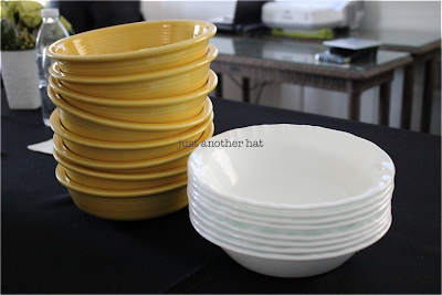 Stacked Corelle bowls against stoneware bowls