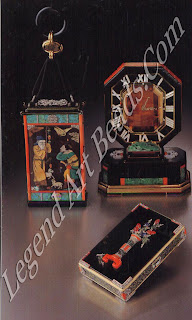 """A jeweled and wood-paneled vanity case made by the Lavabre workshop (1924), with Chinese mythological figures inlaid with mother-of-pearl, malachite, lapis-lazuli, turquoise, coral, and diamond motifs. On the cover a Taoist shepherd, seen conversing with a warrior, who is able to transform rocks into sheep? Inside there are two powder compartments, a comb and a lipstick holder. The two decorative panels (reverse not shown) were made in the Far East during the 19th century and bought by Louis Cartier in Paris. The mystery clock, with a large faceted topaz face decorated with mother-of-pearl numerals, green jade plaques and coral, was made by the Couet workshop in 1927. The octagon is a classic Art Deco stone cut, yet identical geometric shapes are seen in Chinese architecture and design of the 18th century. The jeweled vanity case, from the Lavabre workshop (1928), is decorated with a floral vase and fallen flower; it combines Chinese stylization with the Japanese sentiment of the nursery rhyme: """"Though the colour be fragrant, the flower will fall; who in the world lives forever?"""""""