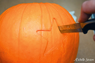 Knife cutting pumpkin