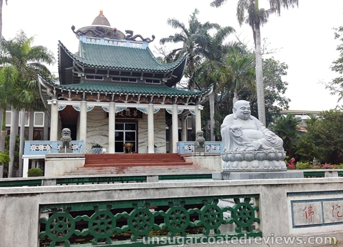 smiling Buddha in front of Lon Wa Buddhist Temple in Davao City, Philippines
