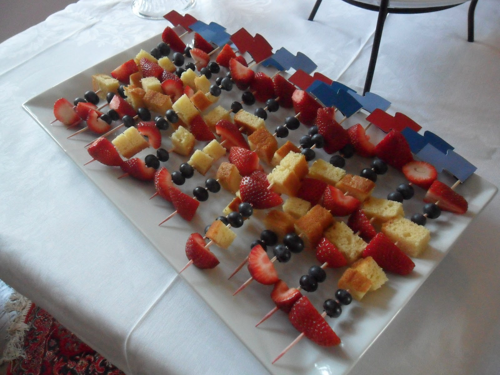 Paint Sample Cards Were Utilized Again, Cut Into Wavy Flags And Attached To  The Fruity Skewers.