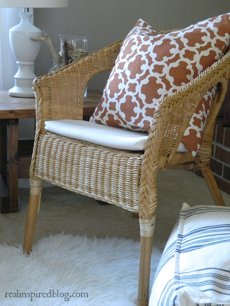 When Decorating Mistakes Aren't Mistakes::fall orange pillow and wicker