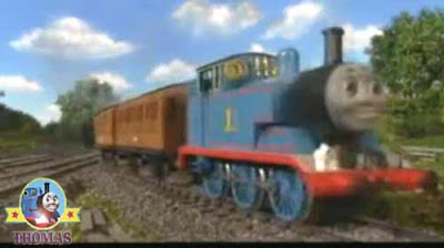 Thomas Annie & Clarabel coaches taking passengers railway small village path leaf covered lines
