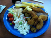 From a previous visit in 2010: crab salad, a green salad with cherry tomtoes, some French fries, fried shrimp and a petite steak.