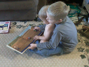 Fall 2011 My Nephew, homeschool grade K, reading to his baby brother...Priceless!