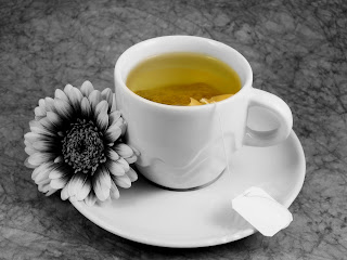 cup-and-saucer-with-green-tea-and-a-flower