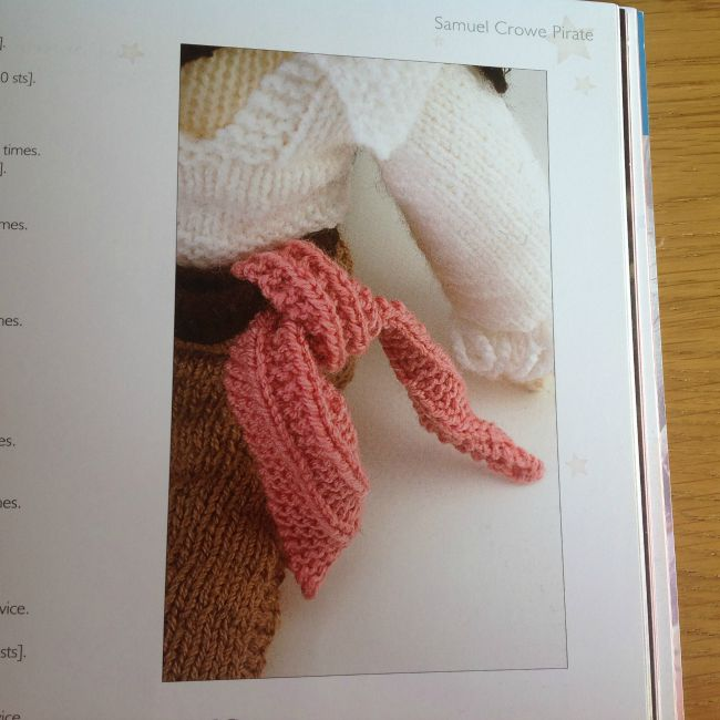 Picture of part of knitted doll showing scarf