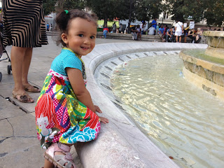 Our daughter trying to climb into a Parisian fountain