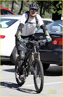 Orlando Bloom Bikes with a friend