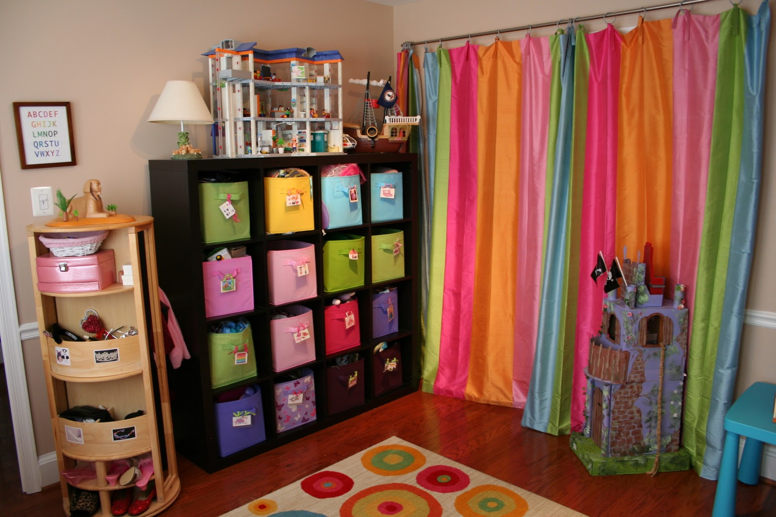 Pink and green mama kid friendly spaces and toy storage for Storage for kids rooms