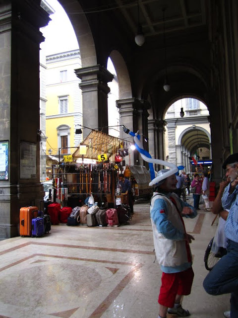 Man wearing a balloon animal hat in Florence, Italy.