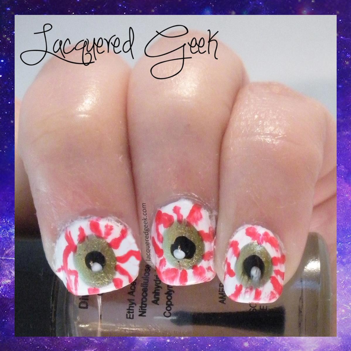 Halloween nail art bloodshot eyes