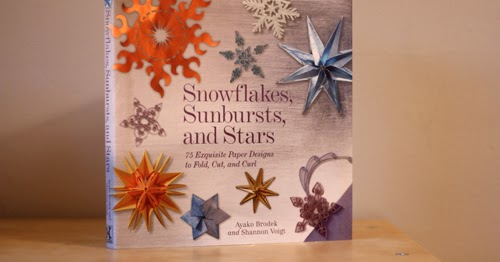 A book of paper snowflake and star instructions