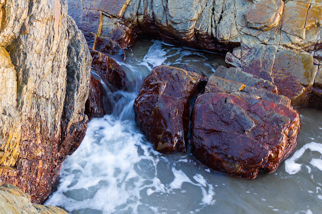red rocks in water at gardiner point