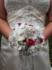 Bouquet I made for my step daughter's wedding, using vintage jewelry and silk flowers