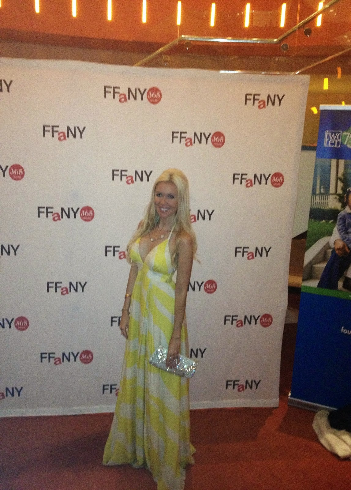 lauren lorraine jones in a yellow dress on the red carpet