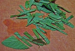 Mint Leaves Julienned on Cutting Board