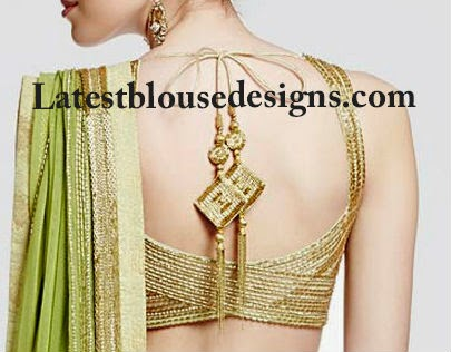 gold blouse with tassels