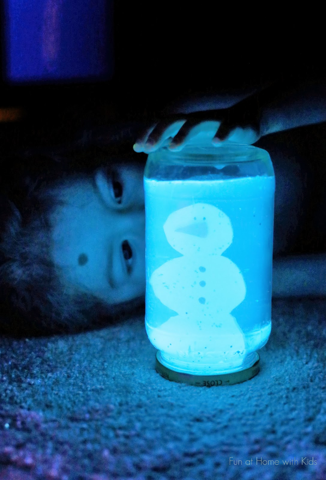 DIY Glowing Snow Globe - quick and easy to make - and it functions just like a regular snow globe in normal light.  From Fun at Home with Kids
