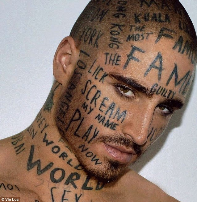 model tattoos face with x rated words in a bid to be the