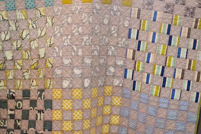 Beige patchwork baby quilt