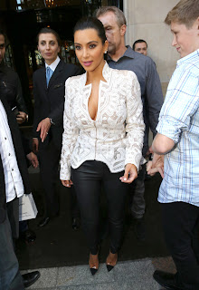 Kim Kardashian hot in leather pants and revealing top