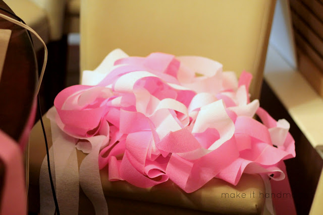 Make an easy Crepe Paper Curtain-- perfect for Valentines Day, Birthday's and Photo Backdrops! Tutorial by Make It Handmade