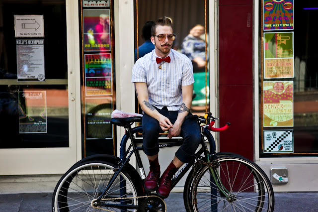 A candidate for hipster of the year spotted having a smoke on a bike rack in Portland.