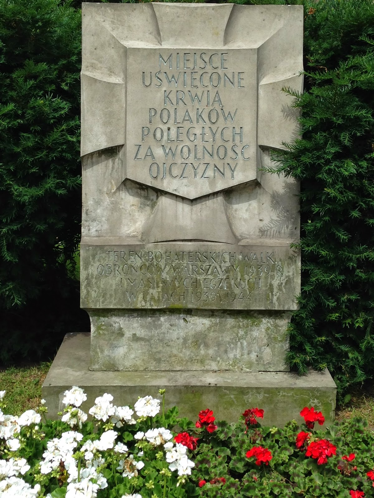 Historical marker of a Nazi massacre of civilian Poles, by Maja Trochimczyk