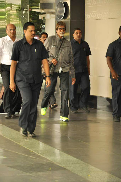 Amitabh Bachchan snapped in green florescent sports shoes
