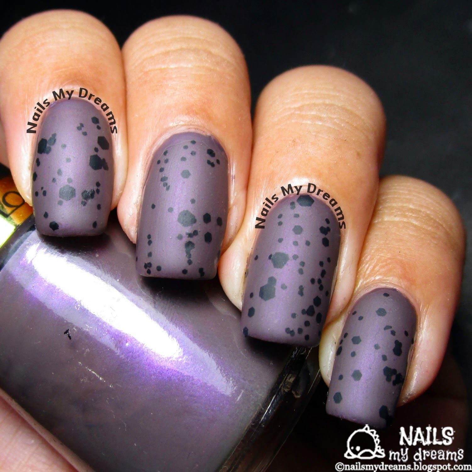 dark purple speckled nail art