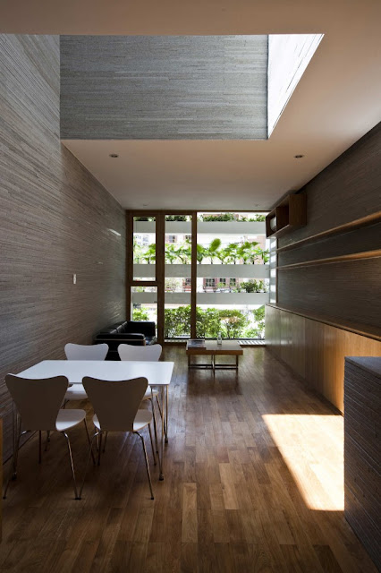 Photo of modern dining table on the first floor of amazing green home