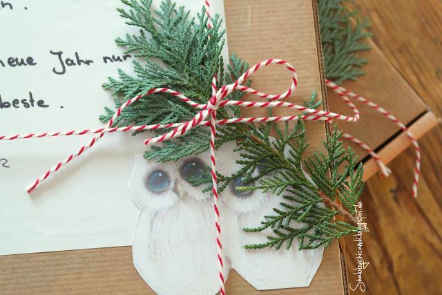 Pizzakarton mit ein bisschen Deko und Weihnachtsgrüße