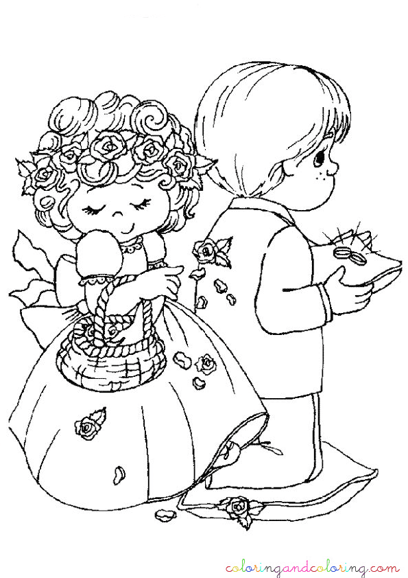 Boy and girl carrying a wedding rings