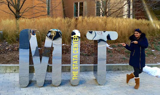 Mir Parvin standing by MIT Letter Display
