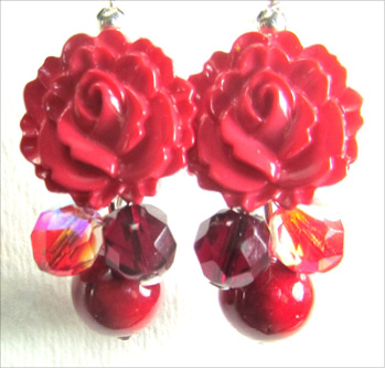 Dangle earrings have flower buttons with red fire polished czech beads and river rock