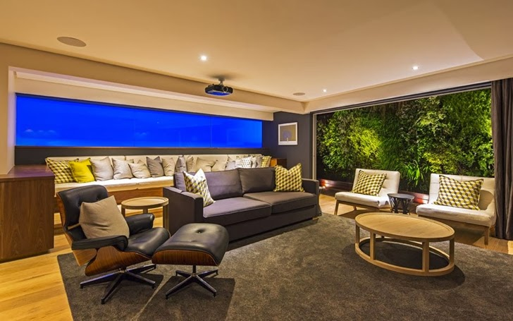 Entertainment room in Modern Mansion by Metropole Architects