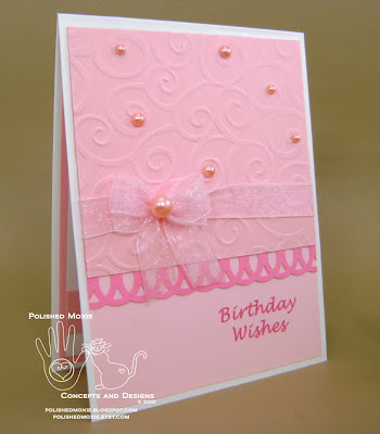 Front of my handmade girly pink birthday card sitting at a right angle.