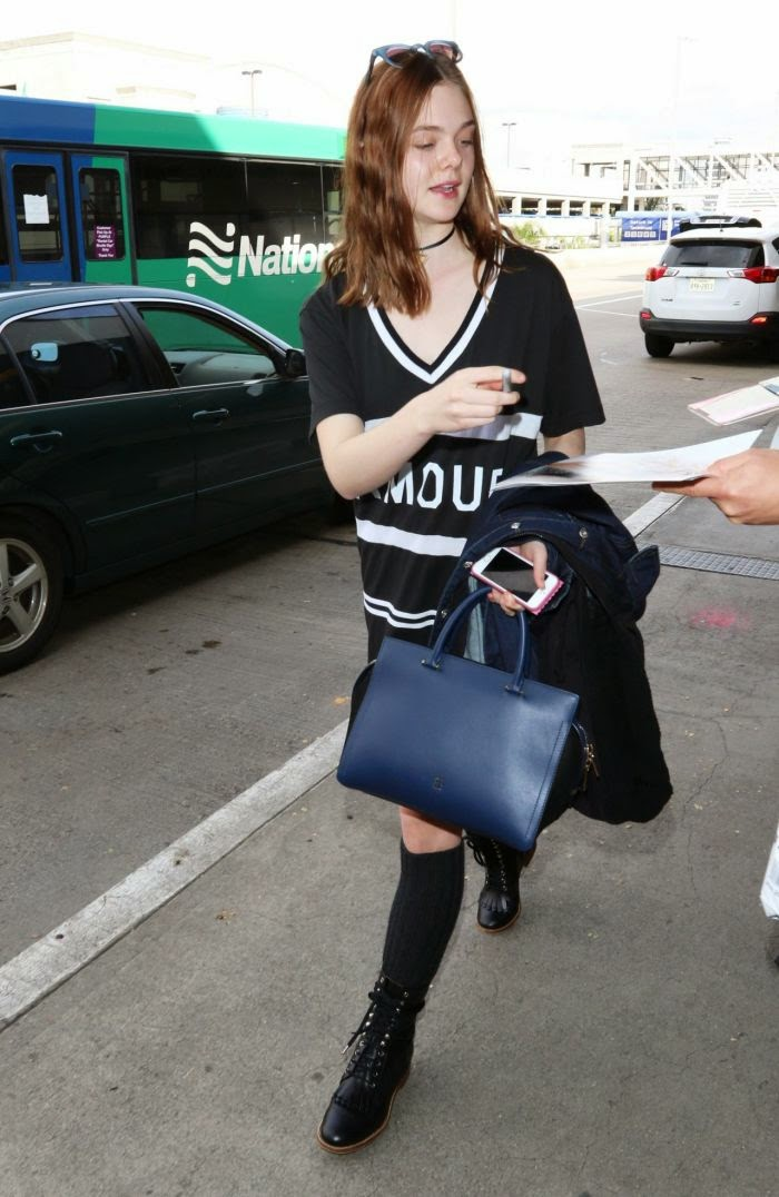 Oh you terminal fancy, huh? The 16-year-old was spotted exiting by herself from LAX airport at Los Angeles, CA, USA on Wednesday, December 17, 2014.