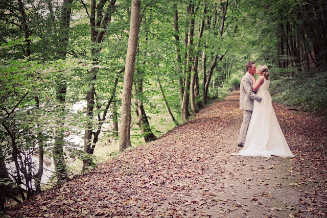 A bride and a groom in a forest in France