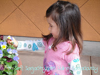 toddler girl picking flower