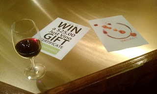 Photo of wine glass and gift card contest poster.
