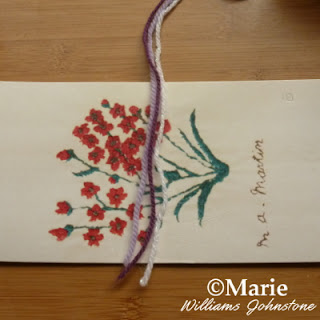 Three strands of yarn over a card