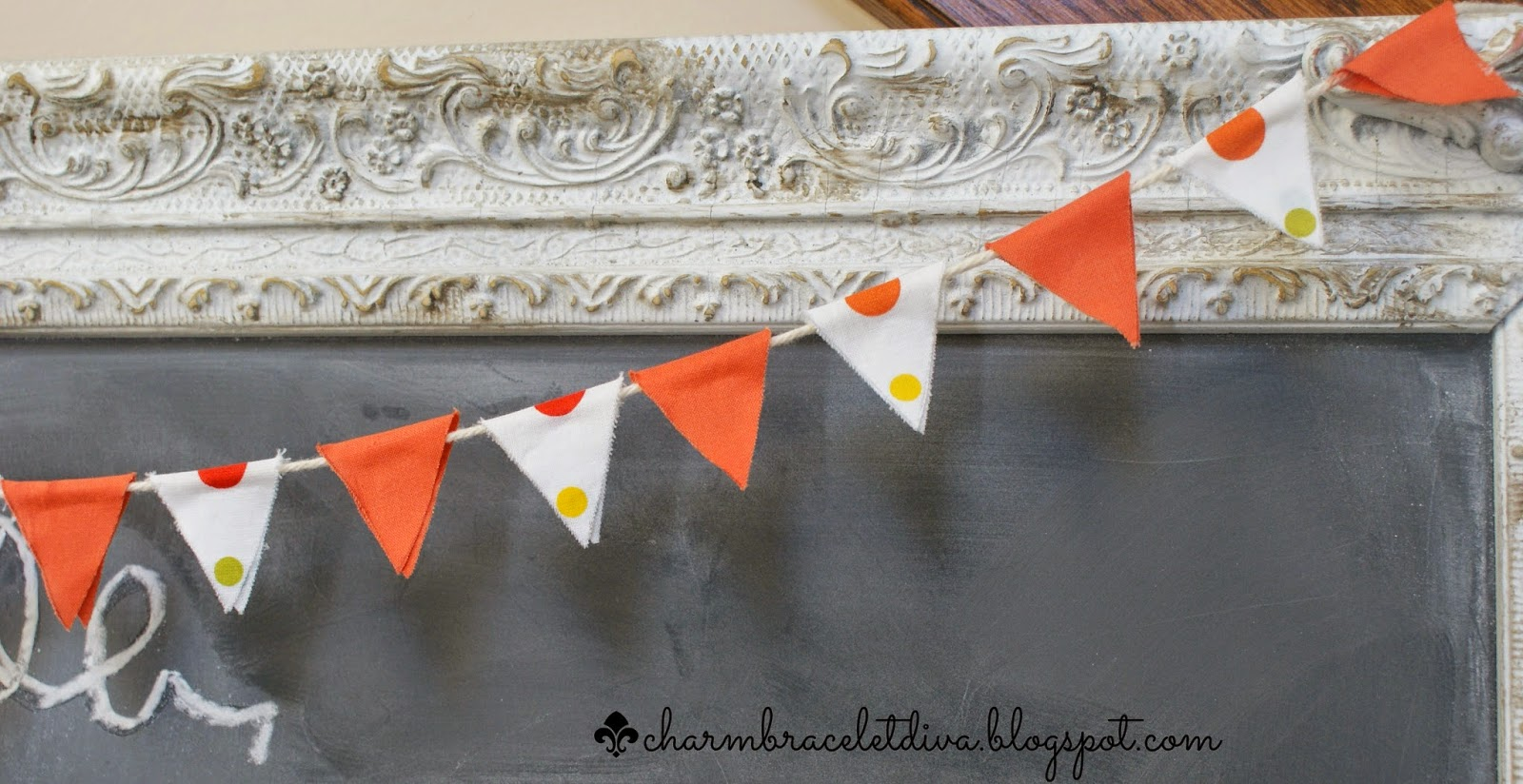 orange and polka dot mini bunting hanging on vintage picture frame
