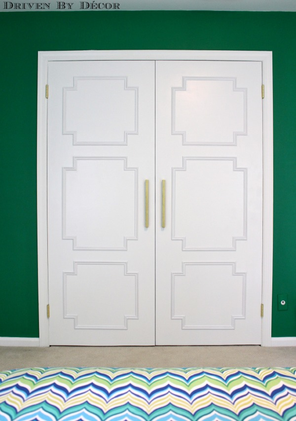 """After"" of flat doors that were transformed by adding molding in geometric pattern"